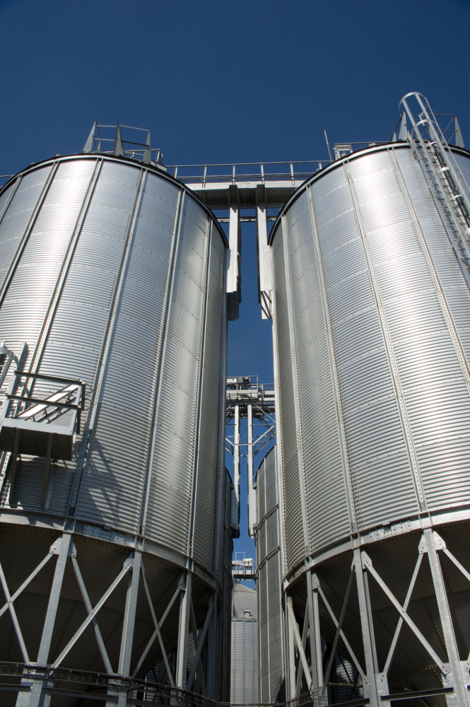 Photo of a big industrial feed mill where grain is processed